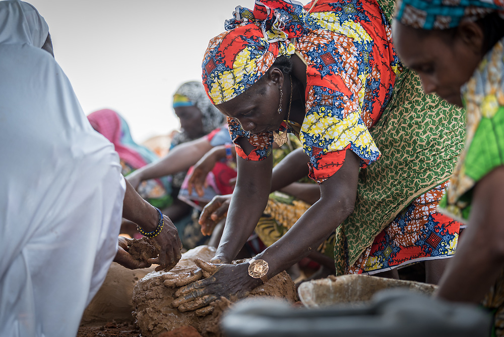 4 June 2019, Meiganga, Cameroon: Women mold new claymade stoves in the Ngam refugee camp. Trained by the Lutheran World Federation, women in the Ngam refugee camp build stoves that retain heat better, and which ensure less firewood is needed in order to cook a meal. Supported by the Lutheran World Federation, the Ngam refugee camp, located in the Meiganga municipality, Adamaoua region of Cameroon, hosts 7,228 refugees from the Central African Republic, across 2,088 households.