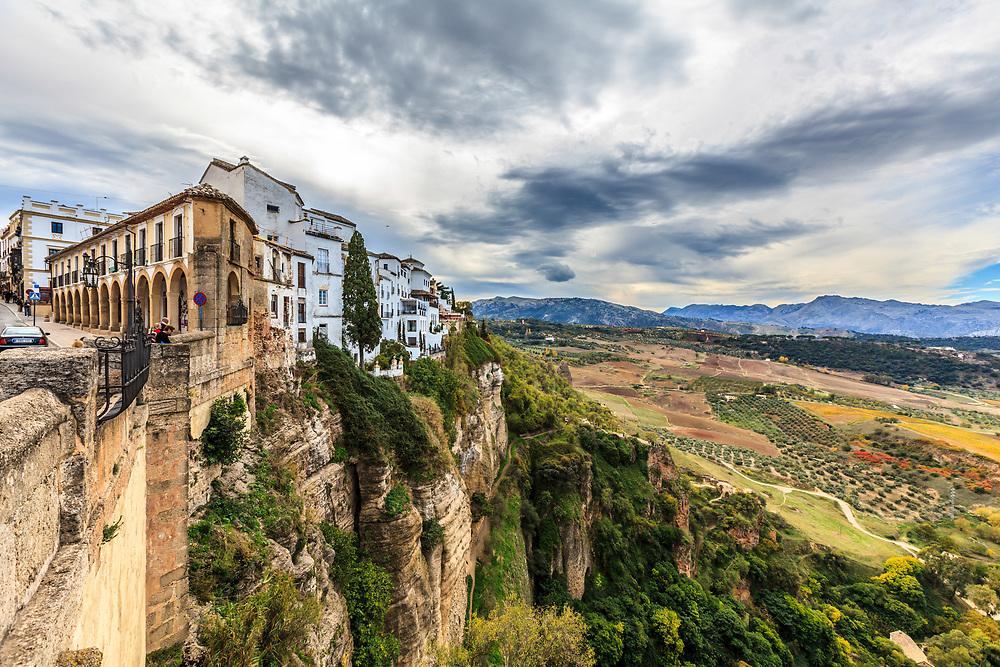 A scene from the Puente Nuevo towards La Ciudad in Ronda, Spain. The old Moorish citadel is called La Ciudad.