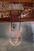 Number 7 identified on concrete ground on New York City construction site.
