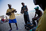 The Makambele Brothers band from the capital Lilongwe. Their instruments are  made out of recycled tin from NGO donations and  carved wood metal strings. They entertain the locals and foreign tourist that have come to enjoy the Lake of Stars music Festival, Chinteche, Malawi.