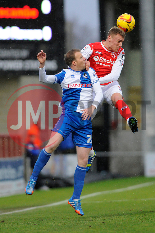 Bristol Rovers' David Clarkson challenges for the ball with Morecambe's Jack Sampson  - Photo mandatory by-line: Dougie Allward/JMP - Tel: Mobile: 07966 386802 14/12/2013 - SPORT - Football - Morecombe - Globe Arena - Morecombe v Bristol Rovers - Sky Bet League Two