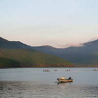 Asia, Japan, Hakone. Boats on Lake Ashi enjoy view of Mt. Fuji in early morning.