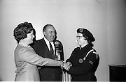 27/3/1966<br /> 3/27/1966<br /> 27 March 1966<br /> <br /> Mrs. T.W.W. Irvine, Wife of the Factory Manager of W.D.&H.O. Wills, Presenting the Trophy to the Leader of the Winning team. Miss A. Meyler(Crumlin) Centre is Mr. Irvine