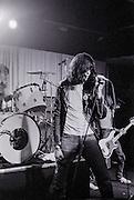 Joey Ramone of the Ramones performing at Ole Man Rivers on Sunday, November 18, 1979 in New Orleans, Louisiana. USA Camera: Olympus OM2 / Film: Kodak Professional Tri-X 400 Black and White Negative Film