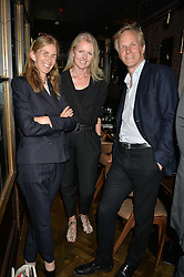 Left to right, ALICE HAETHCOAT AMORY, JOANNE CASH and ED HEATHCOAT AMORY at a dinner hosted by Lucy Yeomans and Amanada Foreman to celebrate the launch of the film Georgiana, Duchess of Devonshire held at sackville's, Sackville Street, London on 7th September 2015.