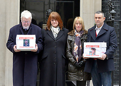 © Licensed to London News Pictures. 28/03/2013. Westminster, UK. (Left - right)   Adrian Thornber, Ann Thornber, Jane Lawton, Nick Lawton. Two families, whose 17-years-old sons both committed suicide after being arrested, have joined forces to deliver a petition to Downing Street calling for the law to be changed to protect all children in custody. Nick and Jane Lawton's son Joe took his own life just two days after being arrested for failing a breath test. Adrian and Ann Thornber lost their son Edward after he was wrongly sent a letter to attend court instead of a warning after being caught with 50p worth of cannabis. In both cases the parents had not been informed of the arrest.. Photo credit : Stephen Simpson/LNP