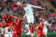 Dele Alli of England heads towards goal. FIFA World cup qualifying match, european group F, England v Malta at Wembley Stadium in London on Saturday 8th October 2016.<br /> pic by John Patrick Fletcher, Andrew Orchard sports photography.
