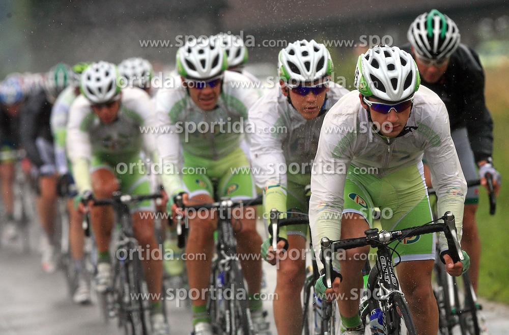 Riders of team Perutnina Ptuj (from L:  Gregor Gazvoda of Slovenia (Perutnina Ptuj), Kristjan Fajt of Slovenia (Perutnina Ptuj), Kristjan Durasek of Croatia (Perutnina Ptuj) and at right Jure Golcer of Slovenia (LPR Brakes)) leading the peloton in last 4th stage of the 15th Tour de Slovenie from Celje to Novo mesto (157 km), on June 14,2008, Slovenia. (Photo by Vid Ponikvar / Sportal Images)/ Sportida)