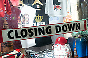 Sign for a souvenir shop which is closing down in London, United Kingdom. Economic times are tough so many shops change ownership.