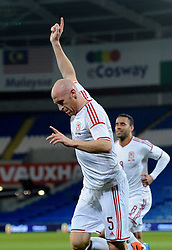 James Collins of Wales (West Ham) celebrates his goal. - Photo mandatory by-line: Dougie Allward/JMP - Tel: Mobile: 07966 386802 03/03/2014 -