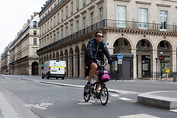 Cyclist on Rivoli Street in Paris on May 4, 2020, on the forty-ninth day of a strict lockdown in France, in place to attempt to stop the spread of the new coronavirus (COVID-19). Photo by Raphael Lafargue/ABACAPRESS.COM