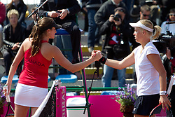 Rebecca Marino of Canada and Masa Zec Peskiric of Slovenia during the first day of the tennis Fed Cup match between Slovenia and Canada at Bonifika, on April 16, 2011 in Koper, Slovenia.  (Photo by Vid Ponikvar / Sportida)