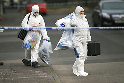 © Licensed to London News Pictures. 10/05/2016. Belfast, Northern Ireland, Forensic Science teams leave the area of Lady Street in west Belfast following the shooting of a man in his 50's late Monday evening. Dan Murray, a takeaway delivery driver, had been taking an order to Lady Street, near Grosvenor Road, when he was shot at about 22:15 BST on Monday. Murder victim Dan Murray had survived a previous gun attack in May 2015. This was the 3rd shooting within 24 hours.  Photo credit : Paul McErlane/LNP