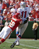 Kansas City's Derrick Thomas (58) dives into New England quarterback Drew Bledsoe (11) at Arrowhead Stadium in Kansas City, Missouri on October 10, 1999.