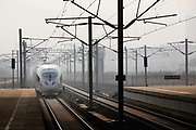 A high-speed train linking Shanghai and Nanjing enters the rail station in Nanjing, China on 04 March, 2011.  In just a few years, China has built the world's longest high-speed rail network, named China Rail High-speed (CRH), and continues to expand despite accusations of technology pilfering and safety concerns. On July 23rd, 2011, two high-speed trains in eastern China collided due to supposed malfunctioning in the signaling system, killing 40 and injuring hundreds, meanwhile a slew of corruption scandals at China's rail ministry has surfaced recently.