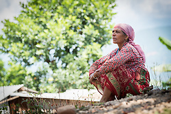17 September 2018, Kavre district, Nepal: Bhagirathi Tiwari rests in the shade. A 55-year-old farmer, Tiwari is a producer of tomatoes, cauliflower, corn and milk. In the community of Maidan, Kavre district, villagers have started to practice semi-commercial vegetable farming, through support from the LWF World Service programme's Post-Earthquake Rehabilitation and Livelihood Recovery Project. Through a collection centre, villagers gather what surplus they have, and bring it collectively to the market in the nearby town of Kuntabesi.