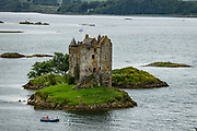 """1440s Castle Stalker is a 4-story tower house or keep picturesquely set on a tidal islet on Loch Laich, an inlet of Loch Linnhe, near Port Appin, Argyll, in Scotland, United Kingdom, Europe. Castle Stalker is visible from the A828 road midway between Oban and Glen Coe. It was occupied from the 1440s-1840, lost its roof, then was fully restored 1965-1974. It appeared in the 1975 film """"Monty Python and the Holy Grail"""" in the final scene as """"The Castle of Aaaaarrrrrrggghhh."""" The name Stalker comes from the Gaelic Stalcaire, meaning hunter or falconer."""