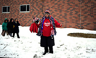 A woman stand in a snowbank and offers souvenirs of U.S. President Donald Trump outside a Trump rally in Des Moines, Iowa, U.S., January 30, 2020. REUTERS/Rick Wilking