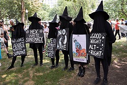 Aug 19, 2017 - Boston, Massachusetts, U.S. - A group of protesters in witch costumes display their signs during the counter rally in the Boston Common in response to Free Speech Rally organized by white nationalists in Boston, MA. (Credit Image: © Alena Kuzub via ZUMA Wire)