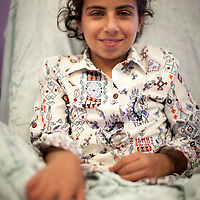 Wajed Wouredat, 11, is attended by nurse Falastine Dirgham in the Paediatric Dialysis Department of the Augusta Victoria Hospital in Jerusalem. The Augusta Victoria Hospital is located on the southern side of Mount of Olives in East Jerusalem and is run by the Lutheran World Federation, LWF. The hospital provides hemodialysis for patients in the West Bank with renal deficiency.
