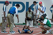 Jon Drummond of the United States refuses to leave track after being disqualified for a false start in the second round heat of the 100 meters in the IAAF World Championships in Athletics at Stade de France on Sunday, Aug, 24, 2003.