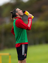 CARDIFF, WALES - Wednesday, September 2, 2020: Wales' captain Gareth Bale drinks from a SIS plastic bottle during a training session at the Vale Resort ahead of the UEFA Nations League Group Stage League B Group 4 match between Finland and Wales. (Pic by David Rawcliffe/Propaganda)