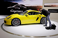 A photographer shoots the new 2014 Porsche Cayman S  at the Los Angeles Auto Show at the LA Convention Center in downtown Los Angeles,  CA. Nov 28, 2012. he show runs through December 9th. Photo by David Sprague Copyright 2012