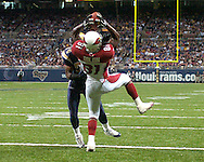 Arizona wide receiver Anquan Boldin (81) catches a pass for a two point conversion over Rams defensive back DeJuan Groce (24) in the fourth quarter at the Edward Jones Dome in St. Louis, Missouri, November 20, 2005.  The Cardinals beat the Rams 38-28.