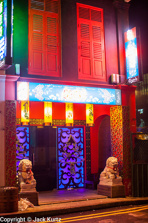 15 DECEMBER 2012 - SINGAPORE, SINGAPORE: The entrance to a karaoke bar on Pekar Street in the Little India section of Singapore.     PHOTO BY JACK KURTZ