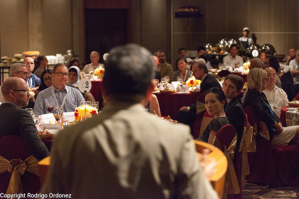 Participants listen as the Chairman of the World Diabetes Foundation, Dr Anil Kapur (foreground, center), makes some remarks before dinner at the global summit on diabetes and tuberculosis in Bali, Indonesia, on November 2, 2015.<br /> The increasing interaction of TB and diabetes is projected to become a major public health issue.The summit gathered a hundred public health officials, leading researchers, civil society representatives and business and technology leaders, who committed to take action to stop this double threat. (Photo: Rodrigo Ordonez for The Union)