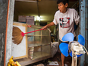 05 OCTOBER 2015 - BANGKOK, THAILAND: SAWAT TANGAON, 70, packs up his belonging in his home in the Wat Kalayanamit neighborhood. Fifty-four homes around Wat Kalayanamit, a historic Buddhist temple on the Chao Phraya River in the Thonburi section of Bangkok, are being razed and the residents evicted to make way for new development at the temple. The abbot of the temple said he was evicting the residents, who have lived on the temple grounds for generations, because their homes are unsafe and because he wants to improve the temple grounds. The evictions are a part of a Bangkok trend, especially along the Chao Phraya River and BTS light rail lines. Low income people are being evicted from their long time homes to make way for urban renewal.        PHOTO BY JACK KURTZ