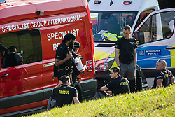 London, UK. 19th April, 2019. A specialist rescue team alongside the main motorway approach to Heathrow airport. A large policing operation was put in place in and around the airport in preparation for expected protests by climate change activists from Extinction Rebellion. Only a very small symbolic protest by teenage activists from Extinction Rebellion Youth took place, dispersed by police officers under threat of arrest.