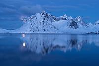 Winter mountain reflection over Reinefjord, Reine, Moskenesøy, Lofoten Islands, Norway