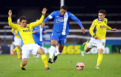 Peterborough United's Nathaniel Mendez-Laing in action with Exter City's Craig Woodman - Photo mandatory by-line: Joe Dent/JMP - Tel: Mobile: 07966 386802 09/11/2013 - SPORT - FOOTBALL - London Road Stadium - Peterborough - Peterborough United v Exeter City - FA Cup - First Round