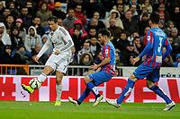 Real Madrid´s Cristiano Ronaldo and Levante UD´s Antonio Garcia Aranda during 2014-15 La Liga match between Real Madrid and Levante UD at Santiago Bernabeu stadium in Madrid, Spain. March 15, 2015. (ALTERPHOTOS/Luis Fernandez)