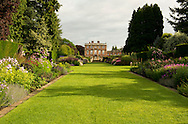 An early morning view of the double herbaceous borders and lawn leading to the house at Newby Hall, Ripon, Yorkshire, UK