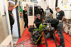 Out of town bikers work on their bikes at the Plebs MC Clubhouse near Stockholm, Sweden. Friday, May 31, 2019. Photography ©2019 Michael Lichter.