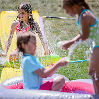 071114       Cable Hoover<br /> <br /> Siraya Askar takes a turn on a slip and slide during the City of Gallup Water Day at Ford Canyon Park Friday.