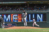 Jeremy Bonderman #32 of the Seattle Mariners reacts after giving up a home run to Josh Willingham #16 of the Minnesota Twins (background) on June 2, 2013 at Target Field in Minneapolis, Minnesota.  The Twins defeated the Mariners 10 to 0.  Photo: Ben Krause