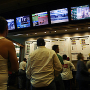 LAS VEGAS, NV - JANUARY 15:  Bettors wait in line to place bets at the sports book inside the Green Valley Ranch Resort and Spa in Las Vegas on January 15, 2005. Sports Illustrated rated the sports book, complete with oversize, leather chairs, as one of the top places in the country to watch sports. (Photo by Todd Bigelow/Aurora)