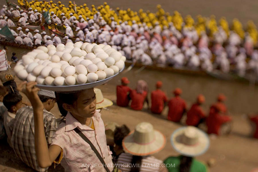 A Cambodian girl sells duck eggs during the Water Festival in Phnom Penh. Despite international concerns about avian flu, eggs and chicken were for sale in Cambodia in November 2005.