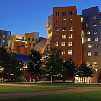 """Cambridge, MA summer night photography of the Ray and Maria Stata Center with the red Mark di Suvero sculpture, Aesops Fables II. The Stata is a Massachusetts Institute of Technology academic complex designed by Pitzker Prize winning architect Frank Gehry. Building 32 is controversy among architects and while some think it is an architectural disaster, Boston Globe architecture columnist Robert Campbell wrote a glowing appraisal of the building in 2004 stating """"The Stata is always going to look unfinished. It also looks as if it's about to collapse. Columns tilt at scary angles. Walls teeter, swerve, and collide in random curves and angles. Materials change wherever you look: brick, mirror-surface steel, brushed aluminum, brightly colored paint, corrugated metal. Everything looks improvised, as if thrown up at the last moment. That's the point. The appearance of the Stata is a metaphor for the freedom, daring, and creativity of the research that's supposed to occur inside it.""""<br /> <br /> Skyline photos of Boston are available as museum quality photography prints, canvas prints, acrylic prints or metal prints. Prints may be framed and matted to the individual liking and decorating needs:<br /> <br /> http://juergen-roth.artistwebsites.com/featured/the-stata-juergen-roth.html<br /> <br /> Good light and happy photo making!<br /> <br /> My best,<br /> <br /> Juergen<br /> http://www.exploringthelight.com<br /> http://www.rothgalleries.com<br /> @NatureFineArt<br /> http://whereintheworldisjuergen.blogspot.com/<br /> https://www.facebook.com/naturefineart"""