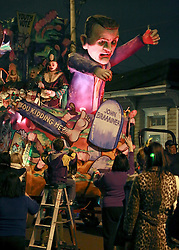 28 Feb 2014. New Orleans, Louisiana.<br /> Mardi Gras. The Krewe D'Etat rolls along Magazine Street through Uptown New orleans. <br /> Photo; Charlie Varley/varleypix.com