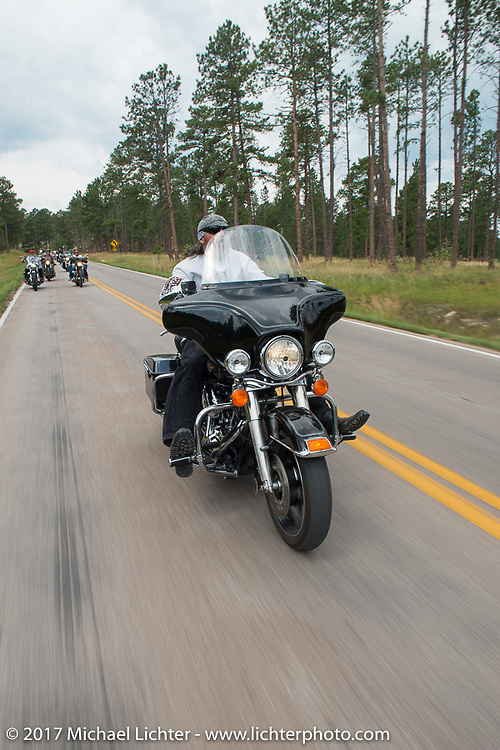 David Campbell on his 2009 Electraglide Classic on the Aidan's Ride to raise money for the Aiden Jack Seeger nonprofit foundation to help raise awareness and find a cure for ALD (Adrenoleukodystrophy) during the annual Sturgis Black Hills Motorcycle Rally. Riding between Nemo and Rapid City, SD, USA. Tuesday August 8, 2017. Photography ©2017 Michael Lichter.