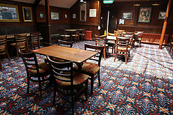 © Licensed to London News Pictures. 03/07/2020. London, UK. Tables set two meters apart in The Toll Gate, a Wetherspoon pub in north London as the pub prepares to reopen on 4 July, the 'Super Saturday'. Pubs across the UK closed on 23 March following the coronavirus lockdown. As COVID-19 lockdown restrictions are eased, pubs will reopen on Saturday 4 July. Some pubs are planning to reopen from 6am. Photo credit: Dinendra Haria/LNP