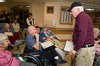 Fred Clavitte U.S. Army is honored with a plaque of appreciation for his service by Dave Shea during the Veteran's Appreciation ceremony at the Belknap County Nursing Home Tuesday afternoon.  (Karen Bobotas/for the Laconia Daily Sun)