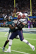 New England Patriots tight end Rob Gronkowski (87) is covered by Philadelphia Eagles cornerback Jalen Mills (31) as he jumps in the air while trying to catch a second quarter pass on an unsuccessful fourth down attempt during the 2018 NFL Super Bowl LII football game against the Philadelphia Eagles on Sunday, Feb. 4, 2018 in Minneapolis. The Eagles won the game 41-33. (©Paul Anthony Spinelli)