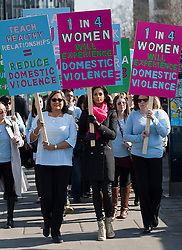 © London News Pictures.  05/03/2013. London, UK. Singer Alesha Dixon (centre) leads victims of domestic violence, families of victims and campaigners across Westminster Bridge to Parliament in London on the lead up to International Women's Day on March 8th. Photo credit: Ben Cawthra/LNP