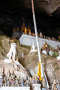Interior view of the many Buddha statues that are found within the famous Pak Ou Caves, Laos, along the Mekong River.
