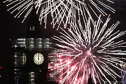 © Licensed to London News Pictures. 01/01/2018. London, UK. Fireworks on the Thames by Parliament and Big Ben herald the start of the New Year. Photo credit: Peter Macdiarmid/LNP